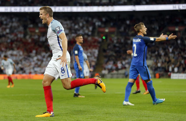 <p>England's Eric Dier, left, celebrates after scoring his side's first goal during the World Cup Group F qualifying soccer match between England and Slovakia at the Wembley stadium in London, Great Britain, Monday, Sept. 4, 2017. (AP Photo/Frank Augstein) </p>