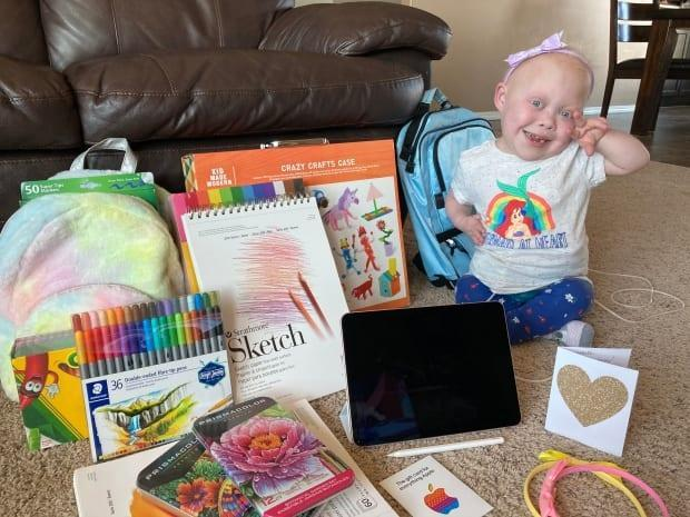 Bella Thomson's inspirational videos drew a care package of gifts from pop singer Halsey.  (Submitted by Kyla Thomson - image credit)