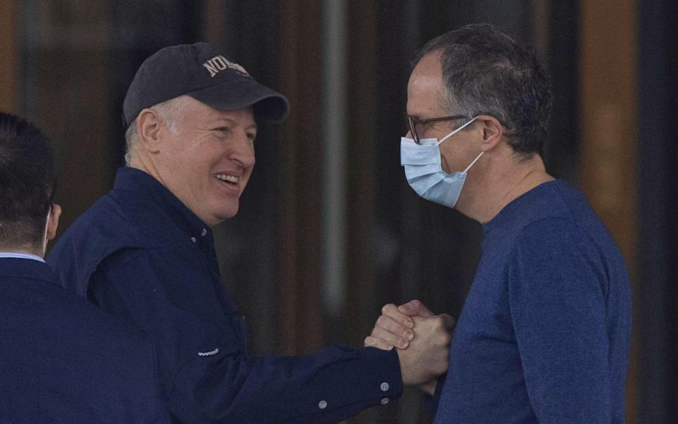 Peter Daszak (L) with Peter Ben Embarek (R), the head of the WHO mission in China, outside their hotel in Wuhan last month - ALEX PLAVEVSKI/EPA-EFE/Shutterstock