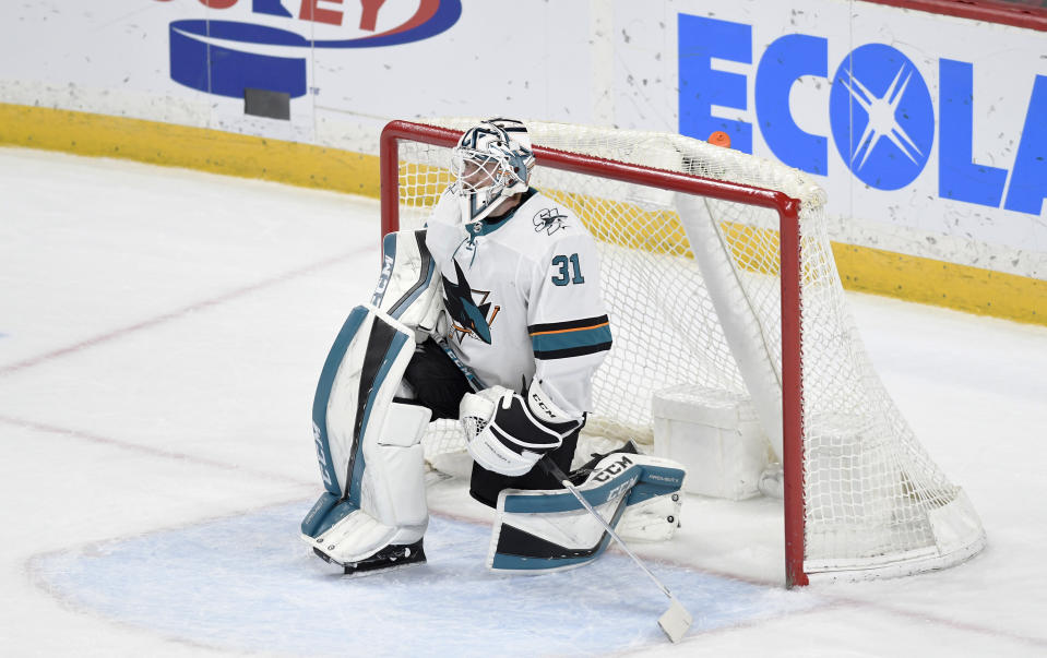 San Jose Sharks' goalie Martin Jones rests in his goal as the Minnesota Wild take a time-out in the third period of an NHL hockey game, Saturday, Feb. 15, 2020, in St. Paul, Minn. San Jose won 2-0.(AP Photo/Tom Olmscheid)