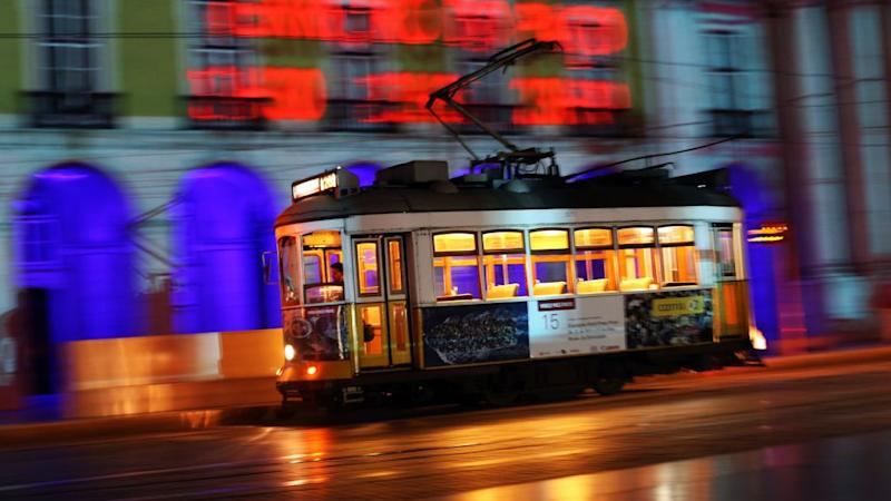 In this photo taken with slow shutter speed, a tram driver steers a tram at the Comercio square in Lisbon, Thursday, May 28, 2015. The tram is a very common public transport among locals and visitors to move within the Portuguese capital. (AP Photo/Francisco Seco)