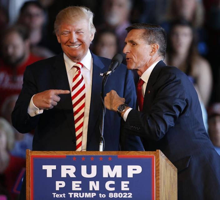 Donald Trump (L) jokes with retired Gen. Michael Flynn as they speak at a rally at Grand Junction Regional Airport on October 18, 2016 in Grand Junction Colorado. (Photo: George Frey/Getty Images)