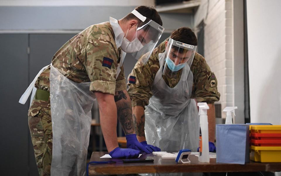 British Army soldiers record and process tests at a coronavirus testing centre in Liverpool - Oli Scarff/AFP