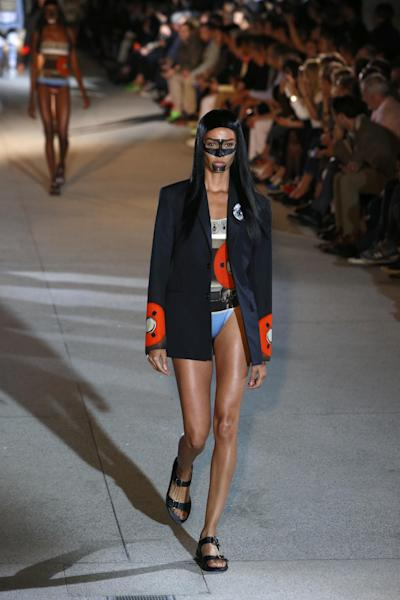 A model presents a creation as part of the Givenchy men's fashion Spring-Summer 2014 collection, presented Friday, June 28, 2013 in Paris. (AP Photo/Francois Mori)