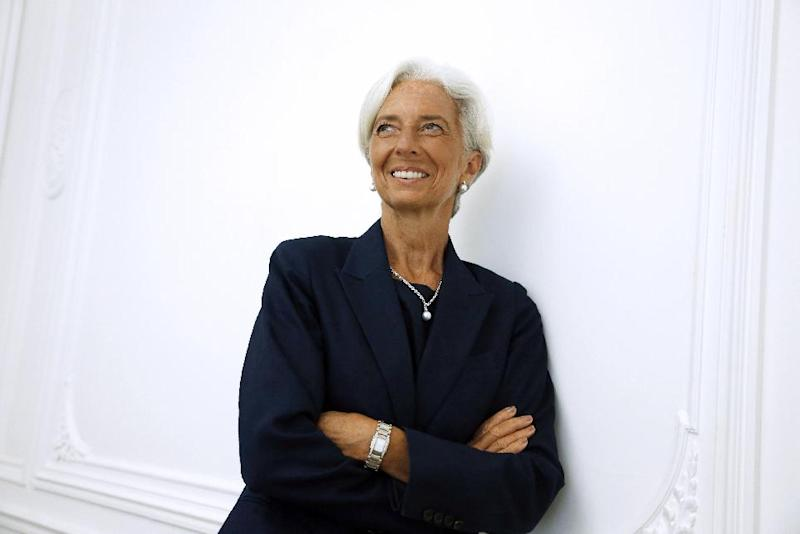 "IMF chief Christine Lagarde poses on the sideline of a press conference, on August 27, 2014 at her lawyer's office in Paris, after announcing she had been charged for ""negligence"" over a multi-million-euro corruption case (AFP Photo/Thomas Samson)"