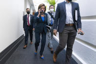 FILE - In this Oct. 1, 2021, file photo House Speaker Nancy Pelosi of Calif., talks on her phone as she arrives for a meeting with House Democrats on Capitol Hill in Washington. (AP Photo/Jacquelyn Martin, File)