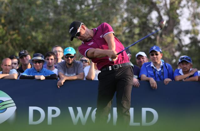 Henrik Stenson from Sweden tees off on the 18th hole during the 2nd round of DP World Golf Championship in Dubai, United Arab Emirates, Friday, Nov. 15, 2013. (AP Photo/Kamran Jebreili)