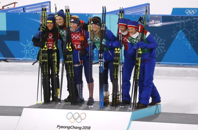 Cross-Country Skiing - Pyeongchang 2018 Winter Olympics - Women's Team Sprint Free Finals - Alpensia Cross-Country Skiing Centre - Pyeongchang, South Korea - February 21, 2018. Gold medalists Kikkan Randall and Jessica Diggins of the U.S, silver medalists Charlotte Kalla and Stina Nilsson of Sweden and bronze medalists Marit Bjoergen and Maiken Caspersen Falla of Norway celebrate during the victory ceremony. REUTERS/Kai Pfaffenbach