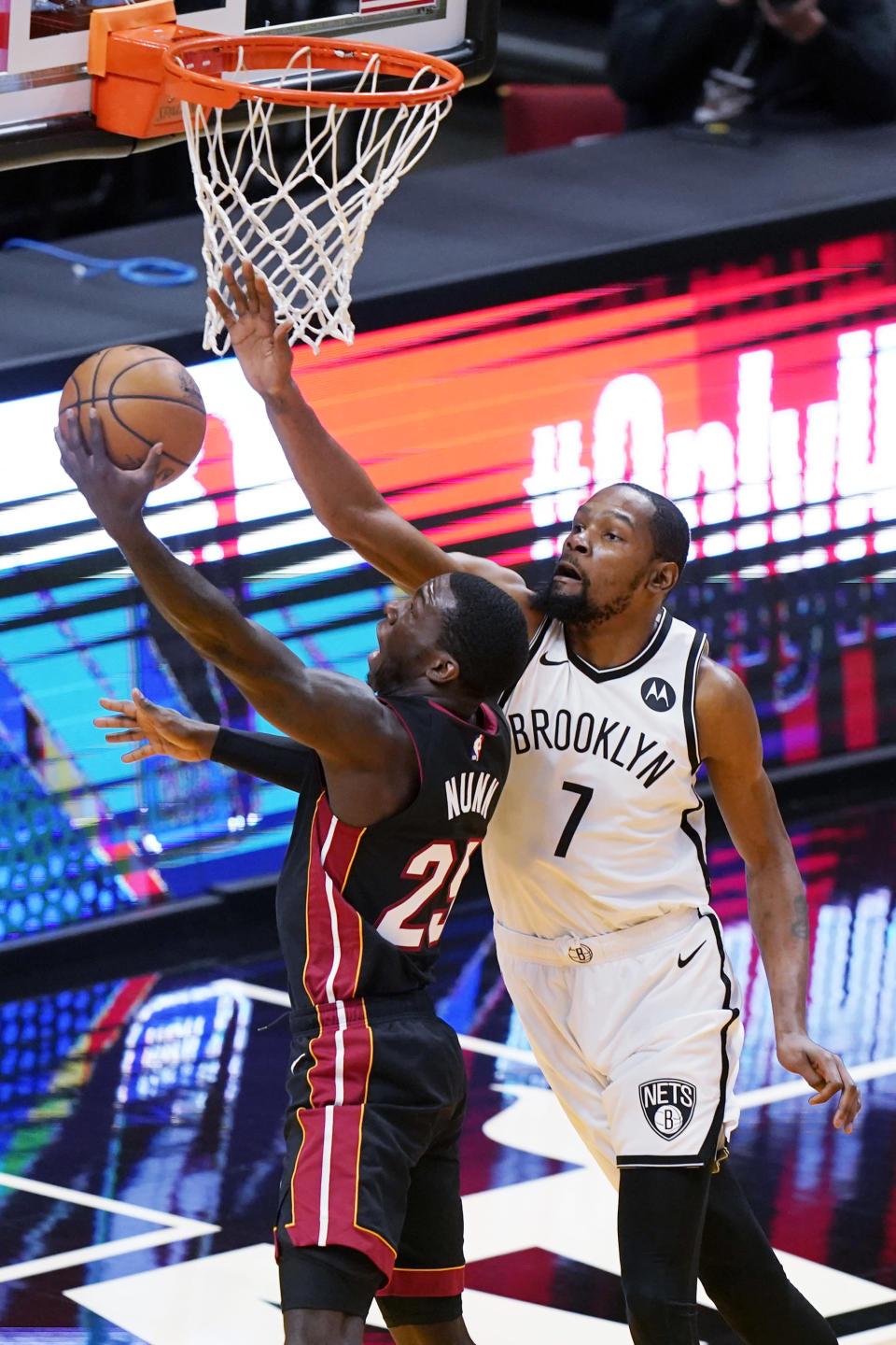 Miami Heat guard Kendrick Nunn (25) goes up for a shot against Brooklyn Nets forward Kevin Durant (7) during the first half of an NBA basketball game, Sunday, April 18, 2021, in Miami. (AP Photo/Wilfredo Lee)