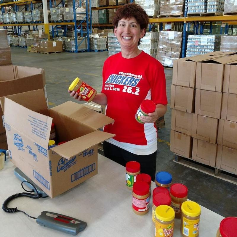 Boxing up peanut butters after a very successful food drive. Nut butters are a high-demand item, especially for kids, families and seniors. (Jess Kurti)