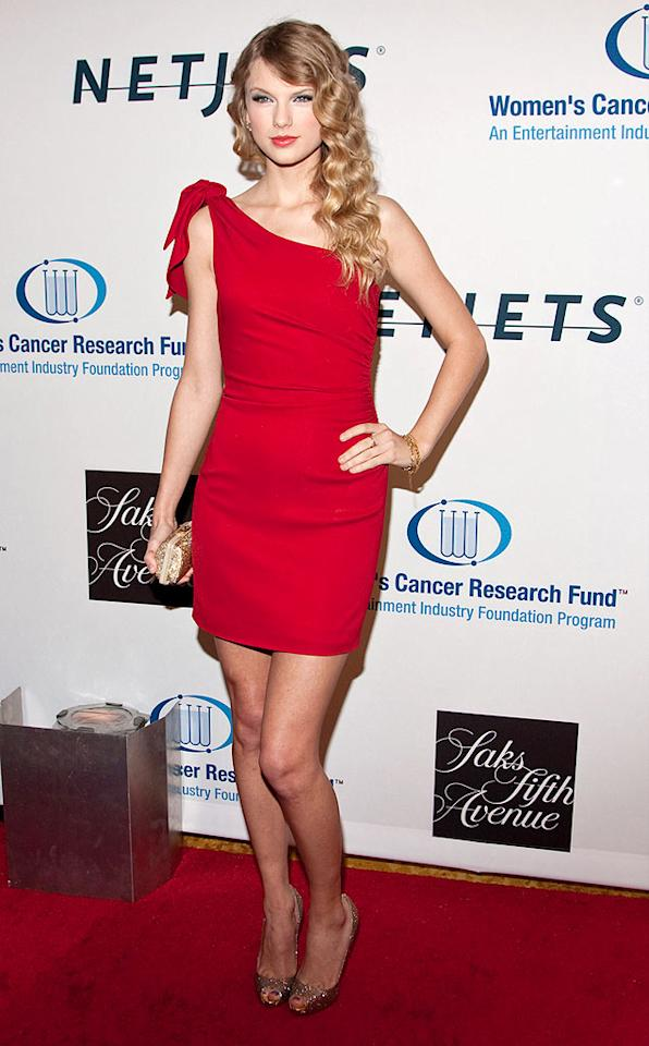 """Country crooner Taylor Swift dazzled in a form-fitting scarlet sheath just days before another red carpet event -- the Grammy Awards, where the 20-year-old is nominated for eight honors! Anna Webber/<a href=""""http://www.wireimage.com"""" target=""""new"""">WireImage.com</a> - January 27, 2010"""