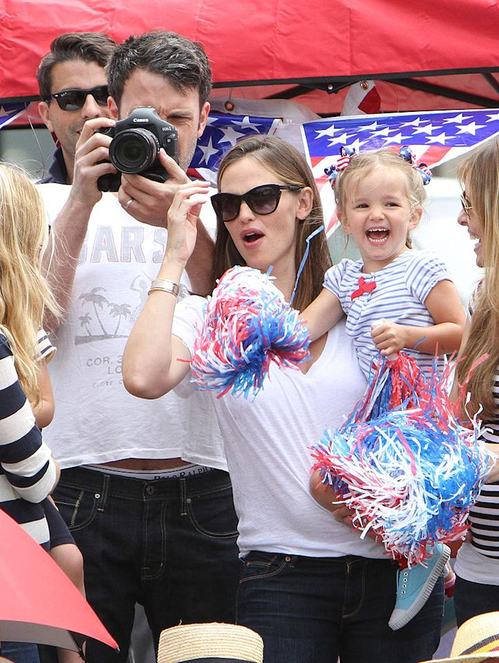 Ben Affleck and Jennifer Garner blended in with the rest of the revelers at a Fourth of July parade in Santa Monica, California. The Hollywood parents brought along their two daughters Seraphina, who showed off her American spirit with red, white, and blue pom-poms and hair bows, and Violet (not pictured). Their 4-month-old son Samuel sat the loud festivities out, but made his debut later, at a private party in nearby Pacific Palisades.
