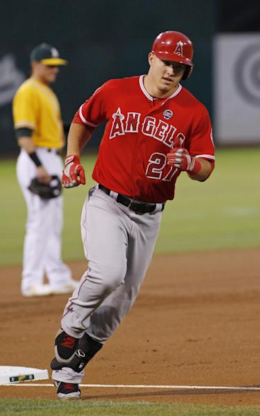 Los Angeles Angels' Mike Trout rounds third base after hitting a home run against the Oakland Athletics during the first inning of a baseball game, Tuesday, Sept. 17, 2013, in Oakland, Calif. (AP Photo/George Nikitin)