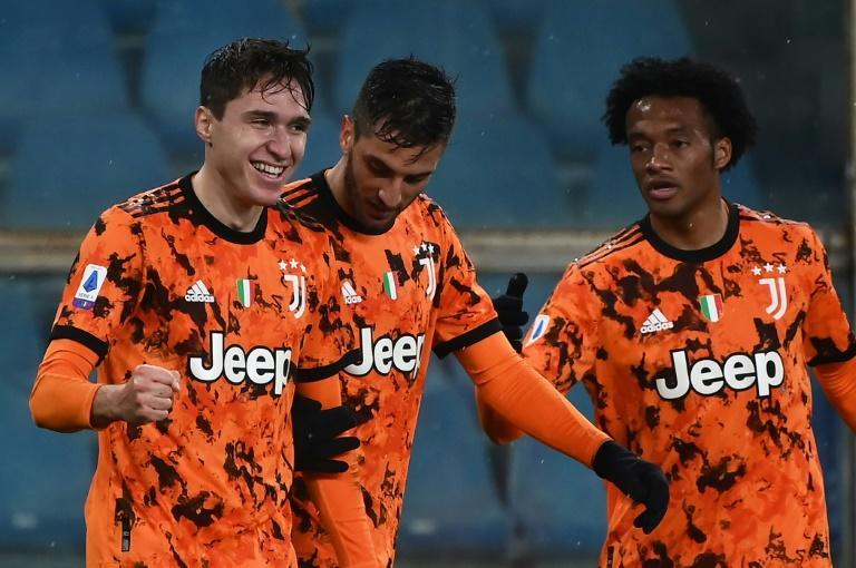 Juventus' midfielder Federico Chiesa (1st-L) scored his fifth league goal this season
