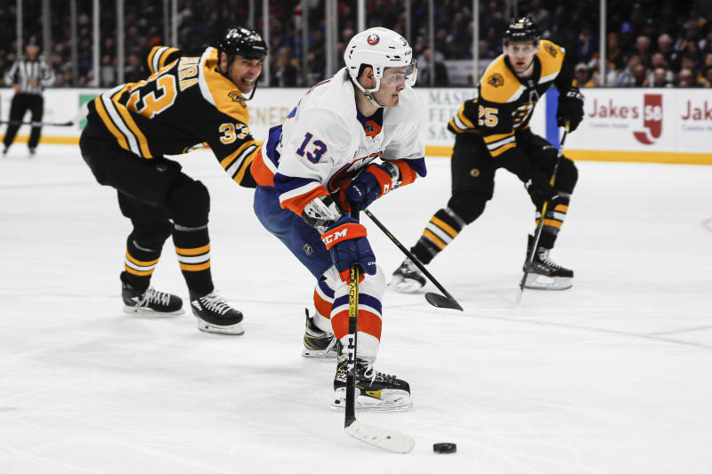 New York Islanders center Mathew Barzal (13) is slashed by Boston Bruins defenseman Zdeno Chara (33) on a breakaway drive to the net during the second period an NHL hockey game, Saturday, Feb. 29, 2020, in Uniondale, NY. (AP Photo/John Minchillo)