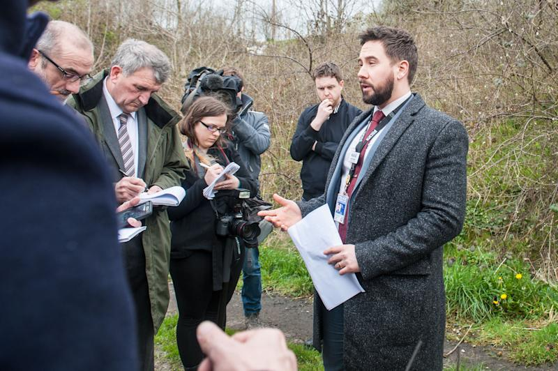Detective Chief Inspector Lewis Hughes, right, addresses the media (Picture: Caters)