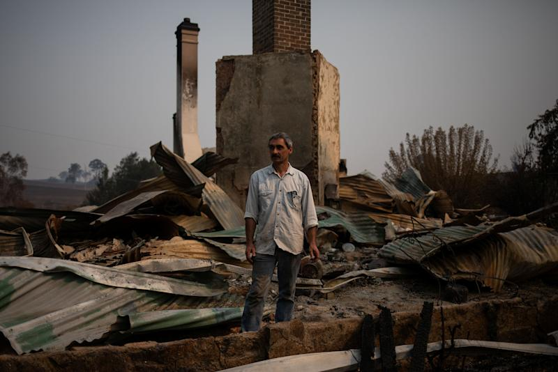 Thousands of people like Philippe Ravenel, pictured here, have lost their homes to the fires. (Photo: Alkis Konstantinidis / Reuters)