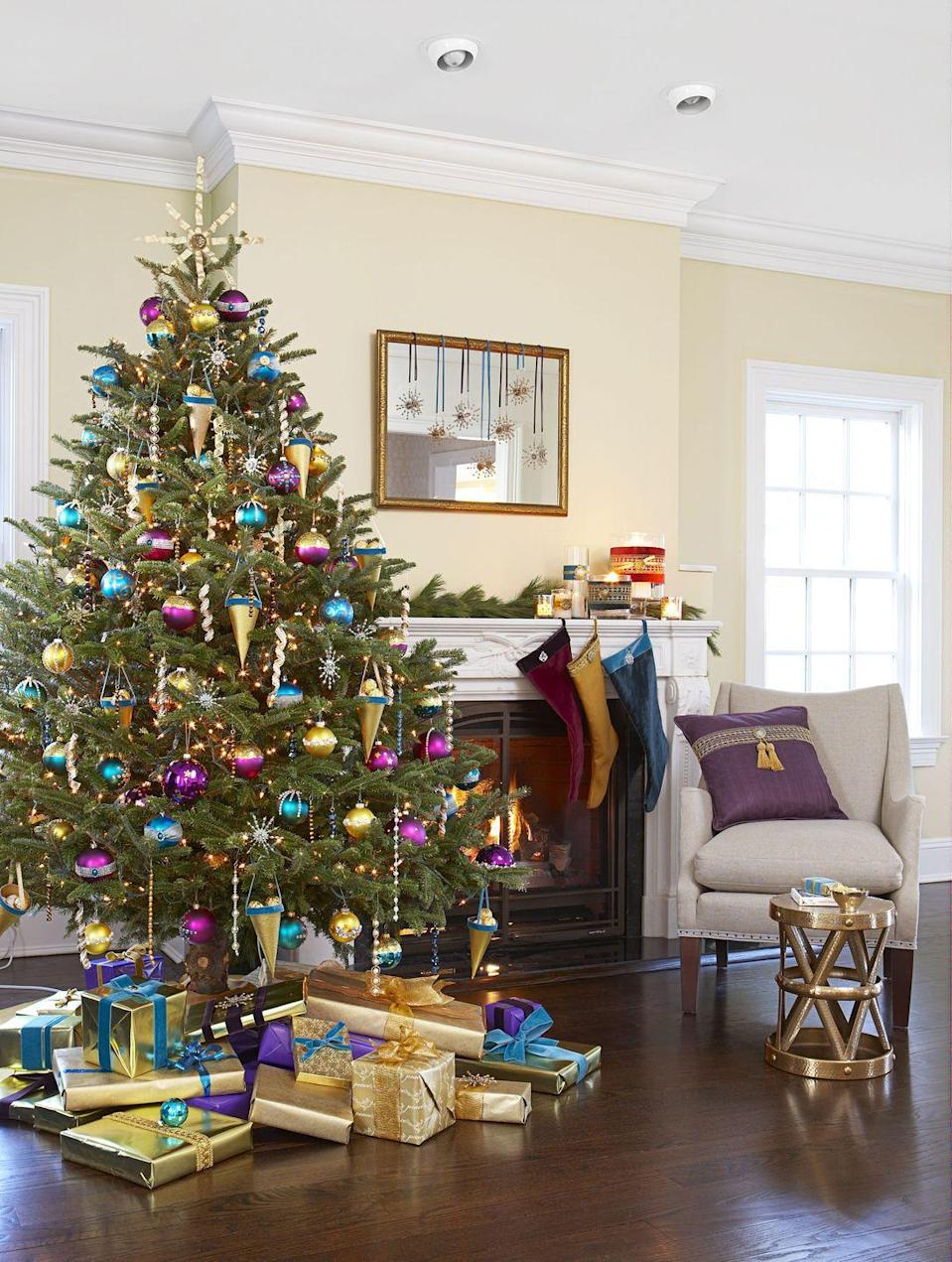 <p>Blue, purple, and gold don't usually appear together during the holidays, but this Magi-inspired fir proves that jewel tones are a holiday must.</p>