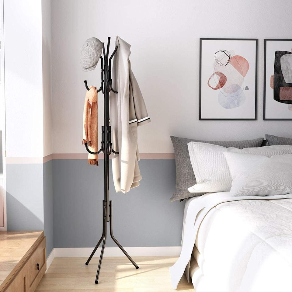 """<p>This <a href=""""https://www.popsugar.com/buy/Langria-Standing-Entryway-Coat-Rack-580844?p_name=Langria%20Standing%20Entryway%20Coat%20Rack&retailer=amazon.com&pid=580844&price=25&evar1=casa%3Aus&evar9=46905095&evar98=https%3A%2F%2Fwww.popsugar.com%2Fphoto-gallery%2F46905095%2Fimage%2F46905097%2FPerfect-For-Hat-Wearers&list1=shopping%2Camazon%2Ccoats%2Cwinter%2Csmall%20spaces%2Csmall%20space%20living%2Cdecor%20inspiration&prop13=api&pdata=1"""" rel=""""nofollow"""" data-shoppable-link=""""1"""" target=""""_blank"""" class=""""ga-track"""" data-ga-category=""""Related"""" data-ga-label=""""https://www.amazon.com/LANGRIA-Standing-Entryway-Hanger-Umbrella/dp/B01H35N3MQ/ref=sr_1_2?dchild=1&amp;keywords=coat+rack+cool&amp;qid=1591812438&amp;s=home-garden&amp;sr=1-2"""" data-ga-action=""""In-Line Links"""">Langria Standing Entryway Coat Rack</a> ($25) has three tiers of hooks so you can easily organize hats along with coats.</p>"""