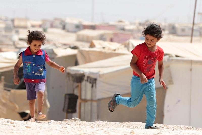 Young Syrian refugees play at the UN-run Zaatari camp, north east of the Jordanian capital Amman, on September 19, 2015 (AFP Photo/Khalil Mazraawi)