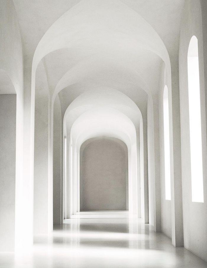 An all-white corridor inside Kim and Kanye's minimalist LA mansion.