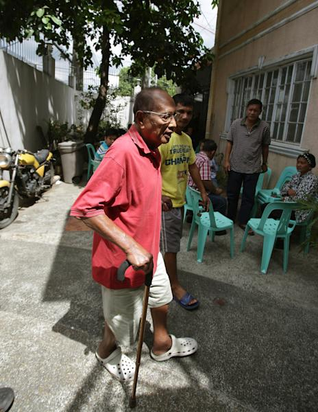 In this Tuesday, March 5, 2013 photo, Filipino Sultan Jamalul Kiram III arrives at his home in Maharlika village in Manila, Philippines after undergoing dialysis at a nearby hospital. Unlike many other Muslim royalties basking in grand palaces and opulent lifestyles, Kiram's kingdom sits in a rundown two-story house in a poor Islamic community in Manila, the only hint of power and glory the title attached to his name. (AP Photo/Aaron Favila)