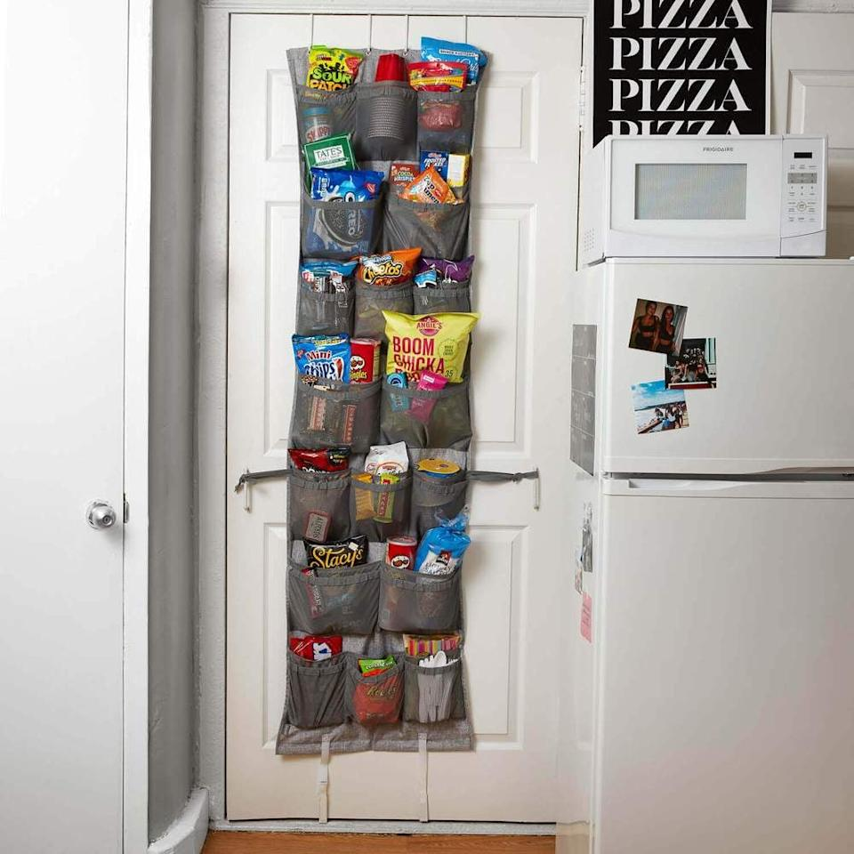 """<p>If you're a Pinterest enthusiast, there's a good chance you've seen this <a href=""""https://www.popsugar.com/buy/36-Pocket-Over--Door-Organizer-466581?p_name=36-Pocket%20Over-the-Door%20Organizer&retailer=dormify.com&pid=466581&price=20&evar1=yum%3Auk&evar9=46362089&evar98=https%3A%2F%2Fwww.popsugar.com%2Ffood%2Fphoto-gallery%2F46362089%2Fimage%2F46362111%2F36-Pocket-Over--Door-Organizer&list1=organization%2Cfood%20storage%2Csmall%20space%20living%2Cdorms&prop13=api&pdata=1"""" rel=""""nofollow"""" data-shoppable-link=""""1"""" target=""""_blank"""" class=""""ga-track"""" data-ga-category=""""Related"""" data-ga-label=""""http://www.dormify.com/products/36-pocket-over-the-door-organizer?variant=17980952936563&amp;currency=USD&amp;utm_source=google&amp;utm_medium=cpc&amp;utm_campaign=google+shopping&amp;gclid=CjwKCAjwmZbpBRAGEiwADrmVXsbpTuvm0fhX5qkgCPlW7WBMzghOXgWTKc-5h6KxEBKwwDwxZ5Z09hoCGXgQAvD_BwE"""" data-ga-action=""""In-Line Links"""">36-Pocket Over-the-Door Organizer</a> ($20) before (or at least one like it!). It's brilliant for storing shoes, but it's even more brilliant for storing snacks. </p>"""