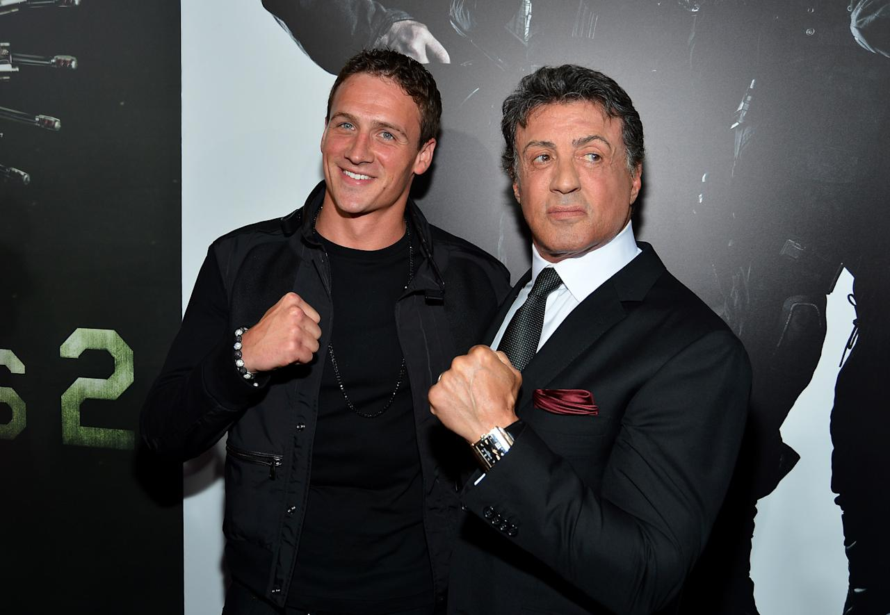 """HOLLYWOOD, CA - AUGUST 15:  Olympic Swimmer Ryan Lochte and Actor/Writer/Director Sylvester Stallone arrives at Lionsgate Films' """"The Expendables 2"""" premiere on August 15, 2012 in Hollywood, California.  (Photo by Frazer Harrison/Getty Images)"""