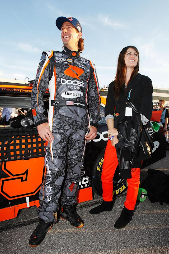 RICHMOND, VA - APRIL 27: Travis Pastrana (L), driver of the #99 Boost Mobile Toyota, and his wife Lyn-Z stand on the grid before the NASCAR Nationwide Series Virginia 529 College Savings 250 at Richmond International Raceway on April 27, 2012 in Richmond, Virginia. (Photo by Todd Warshaw/Getty Images for NASCAR)