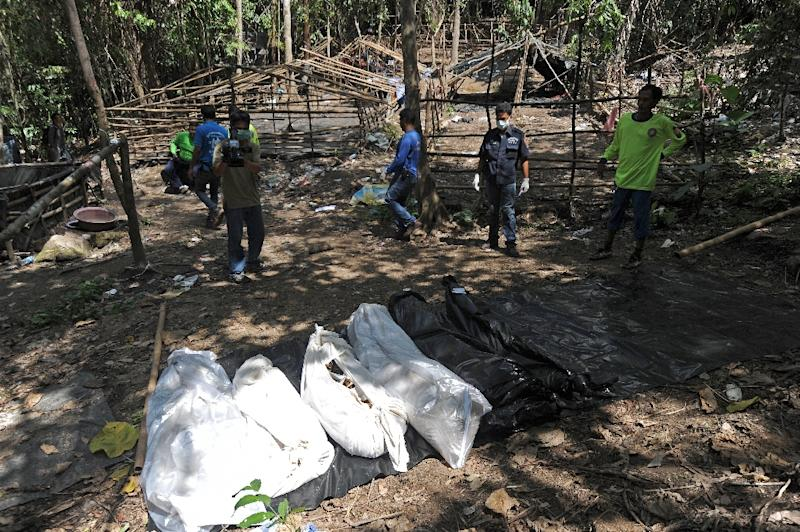 Bags containing skeletons dug out from a mass grave lie in an abandoned jungle camp in the Sadao district of Thailand's southern Songkhla province bordering Malaysia on May 2, 2015 (AFP Photo/Madaree Tohlala)