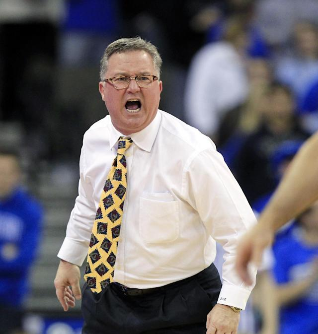 """FILE - In this Feb. 19, 2013 file photo, Southern Illinois head coach Barry Hinson yells during the second half og an NCAA college basketball game against Creighton, in Omaha, Neb. Hinson lambasted his players after a loss at Murray State, calling them """"uncoachable,"""" a """"bunch of mama's boys"""" and comparing disciplining his young team to housebreaking a puppy. Hinson was not made available for comment Wednesday morning, Dec. 18, 2013. (AP Photo/Nati Harnik, File)"""