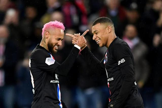 PSG players Neymar (left) and Kylian Mbappe are the two most valuable players in a depressed transfer market, according to KPMG (AFP Photo/MARTIN BUREAU)