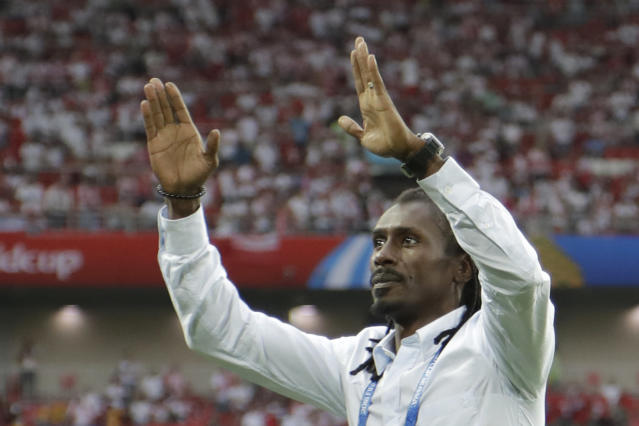 Senegal's head coach Aliou Cisse celebrates as his team won the group H match between Poland and Senegal at the 2018 soccer World Cup in the Spartak Stadium in Moscow, Russia, Tuesday, June 19, 2018. Senegal won 2-1. (AP Photo/Andrew Medichini)