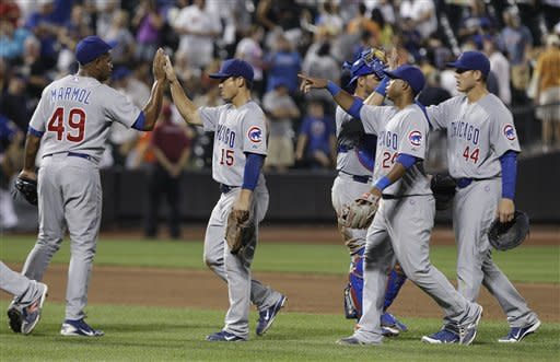 Chicago Cubs relief pitcher Carlos Marmol (49) celebrates with teammates Darwin Barney (15), Luis Valbuena (24) and Anthony Rizzo (44) after the Cubs' 8-7 win in a baseball game against the New York Mets on Friday, July 6, 2012, in New York. (AP Photo/Frank Franklin II)