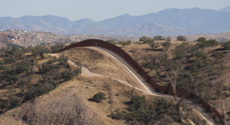 FILE - This Oct. 30, 2011 file photo shows the border fence stretching west of Nogales, Ariz. into the Coronado National Forest. An Arizona lawmaker, Republican state Sen. Steve Smith, who is leading an effort to build additional fences near the state's border with Mexico through donations said he expects to begin construction on more barriers some time next year.  (AP Photo/The Arizona Republic, Michael Chow, File)  MARICOPA COUNTY OUT; MAGS OUT; NO SALES