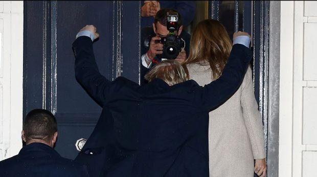 Boris Johnson reacts as he and his girlfriend Carrie Symonds arrive at the Conservative Party's headquarters