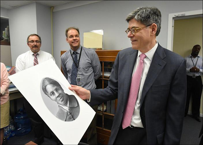 In this US Department of Treasury handout file photo taken on April 20, 2016 shows Treasury Secretary Jacob Lew looking at a rendering of Harriet Tubman during a visit to the Bureau of Engraving and Printing in Washington, DC on April 21, 2016. (Photo by Chris Taylor / Department of Treasury / AFP)