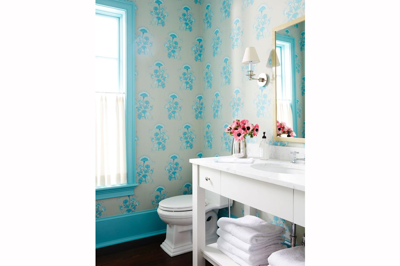 "<p>Painting your trim a vibrant hue ""is like putting a picture frame around your view,"" says <a href=""https://tiltonfenwick.com/about/"" target=""_blank"">designer Anne Maxwell Foster.</a> And no view is better than a beach view.</p> <p><strong>Idea Spotlight:</strong> Match your trim to your wallpaper for a winning combination. Start with the standout pattern first, and then take it to your local paint shop and have them recreate your favorite hue</p>"