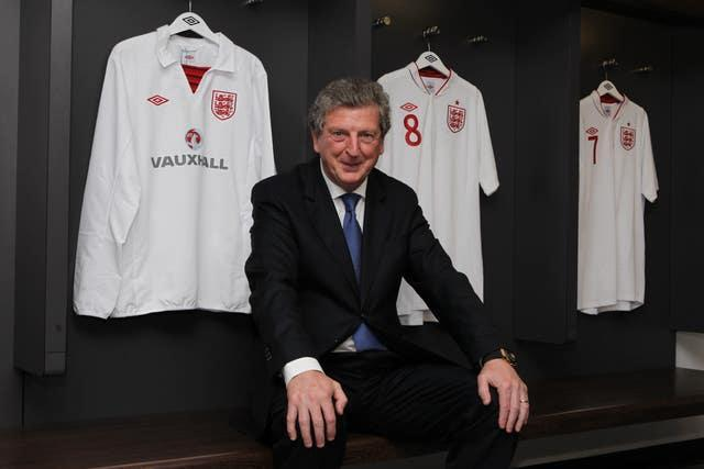 Roy Hodgson poses for a photograph in the dressing room at Wembley Stadium
