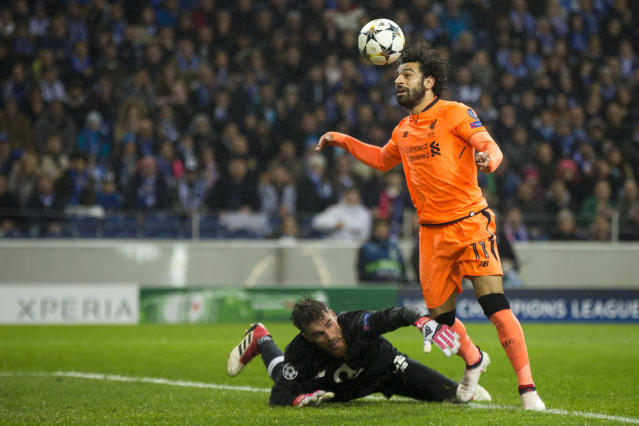 "<a class=""link rapid-noclick-resp"" href=""/soccer/players/mohamed-salah/"" data-ylk=""slk:Mohamed Salah"">Mohamed Salah</a> scores the second goal of <a class=""link rapid-noclick-resp"" href=""/soccer/teams/liverpool/"" data-ylk=""slk:Liverpool"">Liverpool</a>'s 5-0 first-leg rout of Porto in the Champions League round of 16. (Getty)"