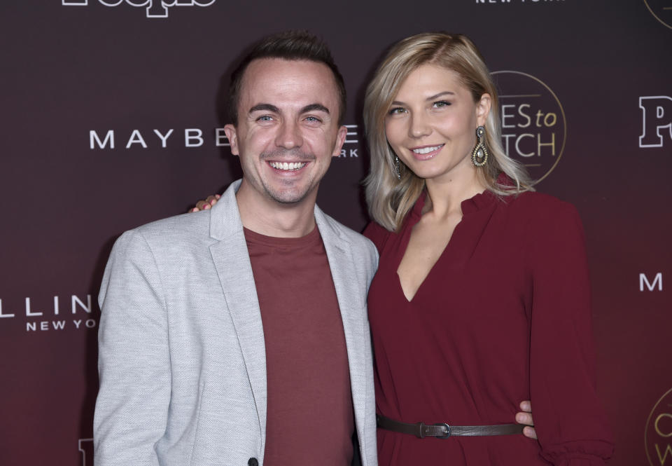 """Frankie Muniz, left, and Paige Price arrive at the 5th annual People Magazine """"Ones To Watch"""" party at NeueHouse Hollywood on Wednesday, Oct. 4, 2017, in Los Angeles. (Photo by Richard Shotwell/Invision/AP)"""