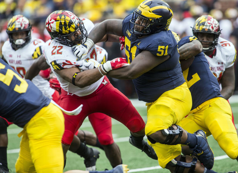 FILE - In this Oct. 6, 2018, file photo, Maryland inside linebacker Isaiah Davis (22) is blocked by Michigan offensive lineman Cesar Ruiz (51) in the second quarter of an NCAA college football game in Ann Arbor, Mich. Ruiz is a possible pick in the NFL Draft which runs Thursday, April 23, 2020, thru Saturday, April 25. (AP Photo/Tony Ding, File)