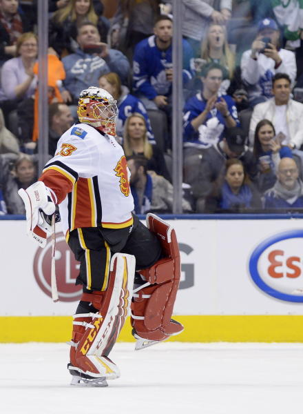 Calgary Flames goaltender David Rittich reacts after making a save to defeat the Toronto Maple Leafs in the shootout of an NHL hockey game Thursday, Jan. 16, 2020, in Toronto. (Nathan Denette/The Canadian Press via AP)