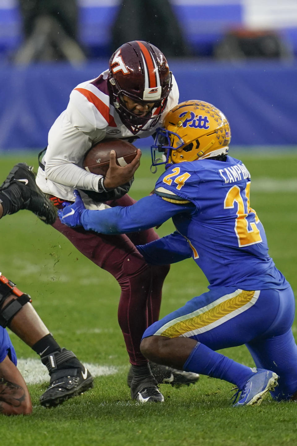 Pittsburgh linebacker Phil Campbell III (24) tackles Virginia Tech quarterback Hendon Hooker (2) on a run during the first half of an NCAA college football game, Saturday, Nov. 21, 2020, in Pittsburgh. (AP Photo/Keith Srakocic)