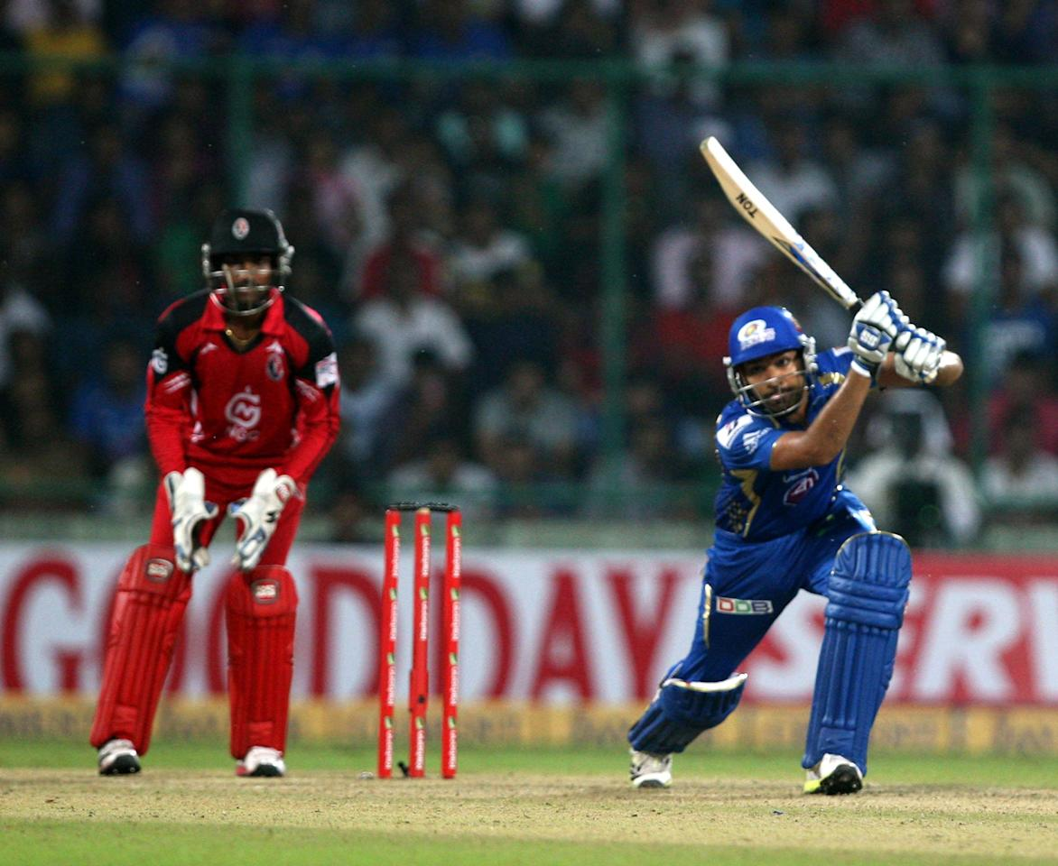 MI captain Rohit Sharma in action during the 2nd CLT20 semi-final match between Mumbai Indians and Trinidad & Tobago at Feroz Shah Kotla, Delhi on Oct. 5, 2013. (Photo: IANS)