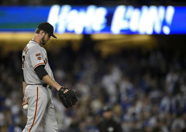 San Francisco Giants starting pitcher Drew Pomeranz reacts after allowing a solo home run to Los Angeles Dodgers' Chris Taylor during the fifth inning of a baseball game in Los Angeles, Monday, April 1, 2019. (AP Photo/Kelvin Kuo)