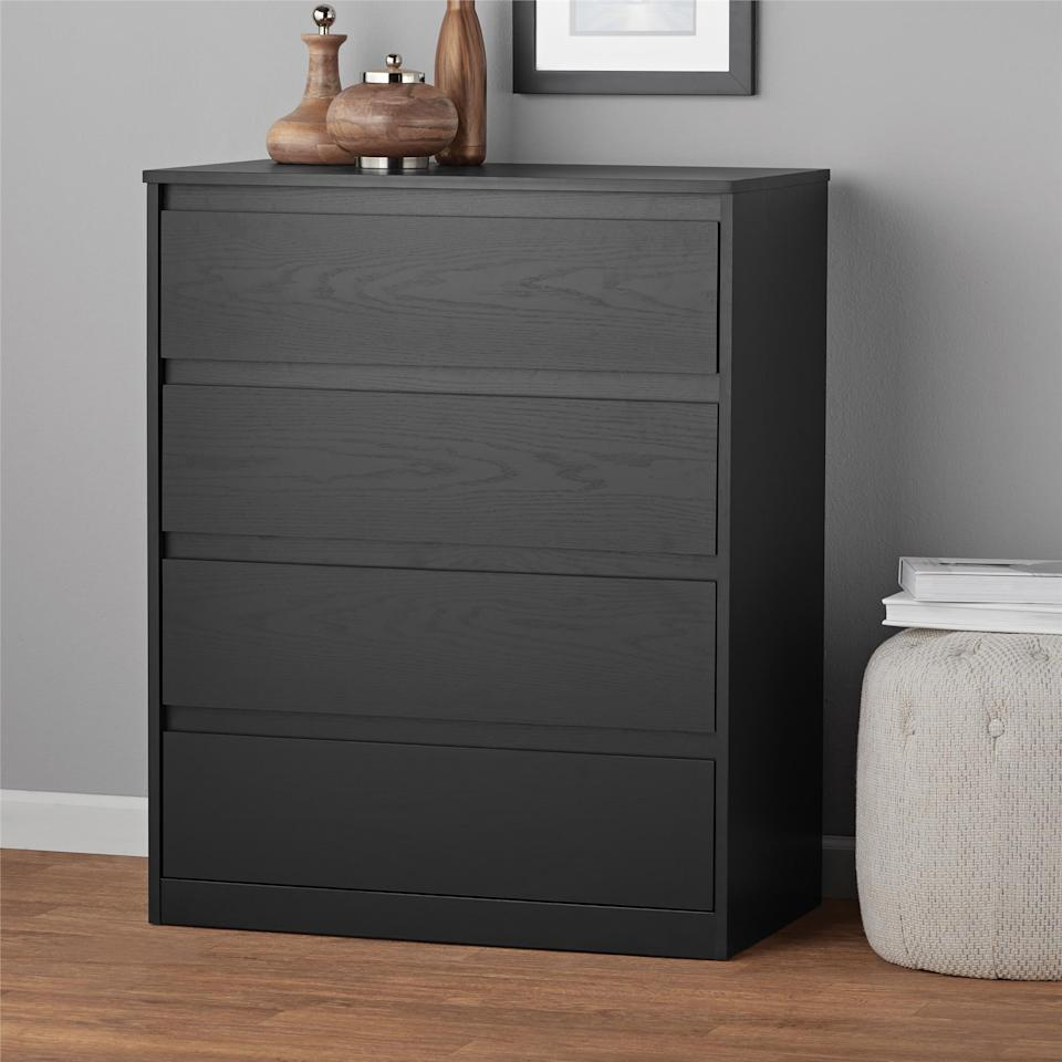 "<p>This <a href=""https://www.popsugar.com/buy/Mainstays%20Westlake%204%20Drawer%20Dresser-472011?p_name=Mainstays%20Westlake%204%20Drawer%20Dresser&retailer=walmart.com&price=90&evar1=casa%3Aus&evar9=46417524&evar98=https%3A%2F%2Fwww.popsugar.com%2Fhome%2Fphoto-gallery%2F46417524%2Fimage%2F46417906%2FMainstays-Westlake-4-Drawer-Dresser&list1=shopping%2Cfurniture%2Cbedrooms%2Chome%20shopping&prop13=mobile&pdata=1"" rel=""nofollow"" data-shoppable-link=""1"" target=""_blank"" class=""ga-track"" data-ga-category=""Related"" data-ga-label=""https://www.walmart.com/ip/Mainstays-Westlake-4-Drawer-Dresser-Multiple-Colors/56211273"" data-ga-action=""In-Line Links"">Mainstays Westlake 4 Drawer Dresser</a> ($90) is great to put inside a closet for extra drawer space.</p>"