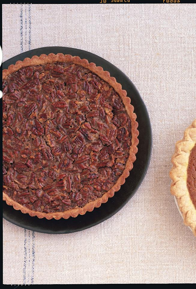 """Pecan desserts are a Thanksgiving tradition, and for good reason! In this refined tart, warm pecans sit atop a rich base, all surrounded by a buttery crust. For a final touch, add whipped cream or vanilla ice cream. <a href=""""https://www.epicurious.com/recipes/food/views/maple-pecan-tart-240422?mbid=synd_yahoo_rss"""">See recipe.</a>"""