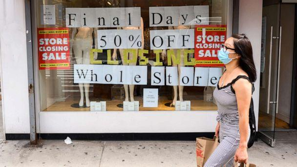 PHOTO: In this Sept. 26, 2020, file photo, a person walks by a going out of business sign displayed outside a retail store in New York. (Noam Galai/Getty Images, FILE)