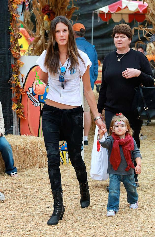 "Hot mama Alessandra Ambrosio walked hand in hand with her cutie, Anja. The 2-year-old got festive with some face paint, while her model mommy carried a holiday-themed cup for her. <a href=""http://www.splashnewsonline.com"" target=""new"">Splash News</a> - October 16, 2010"
